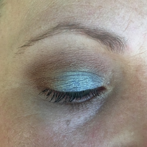BASE: UDAAPP + Jordana Eyeshadow Pencil in Continuous Almond + Darling Girl Glitter Glue. BLENDING: MUFE Vanilla. From the Milani Earthy Elements Palette: the matte tan as transition, the light brown in the crease and the dark brown in the outer corner, the pale shimmer shade in the inner corner. MASCARA: Jordana Best Lash Extreme.
