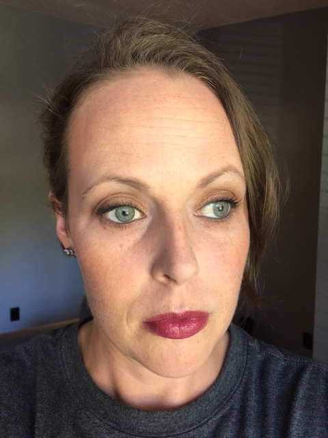 On the face: Revlon Colorstay Whipped foundation in Medium Beige, Urban Decay Color Corrector in Peach, L'Oreal Magic Lumi highlighter, Notoriously Morbid blush in Tempestuous, Notoriously Morbid Highlight in I Though I'd Seen A Ghost, Becca Bronzer. Lips are Burt's Bee's Juniper Water.